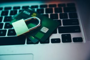 SSL Certificates and mixed content can hurt your rankings. Image of padlock, credit cards and laptop.